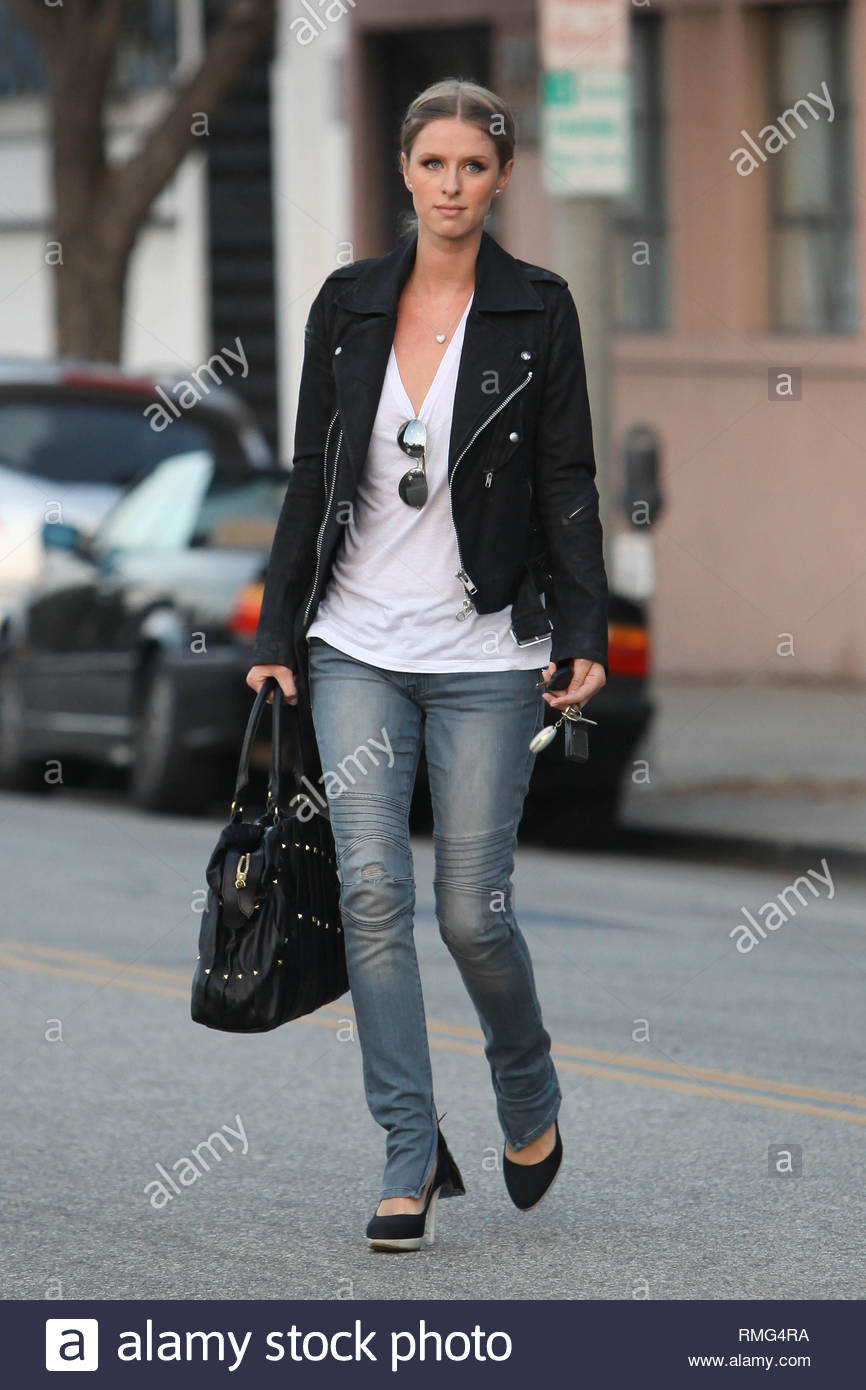 3e1fc507303c ... Hilton looks fashion forward as she steps out in padded biker denim  jeans