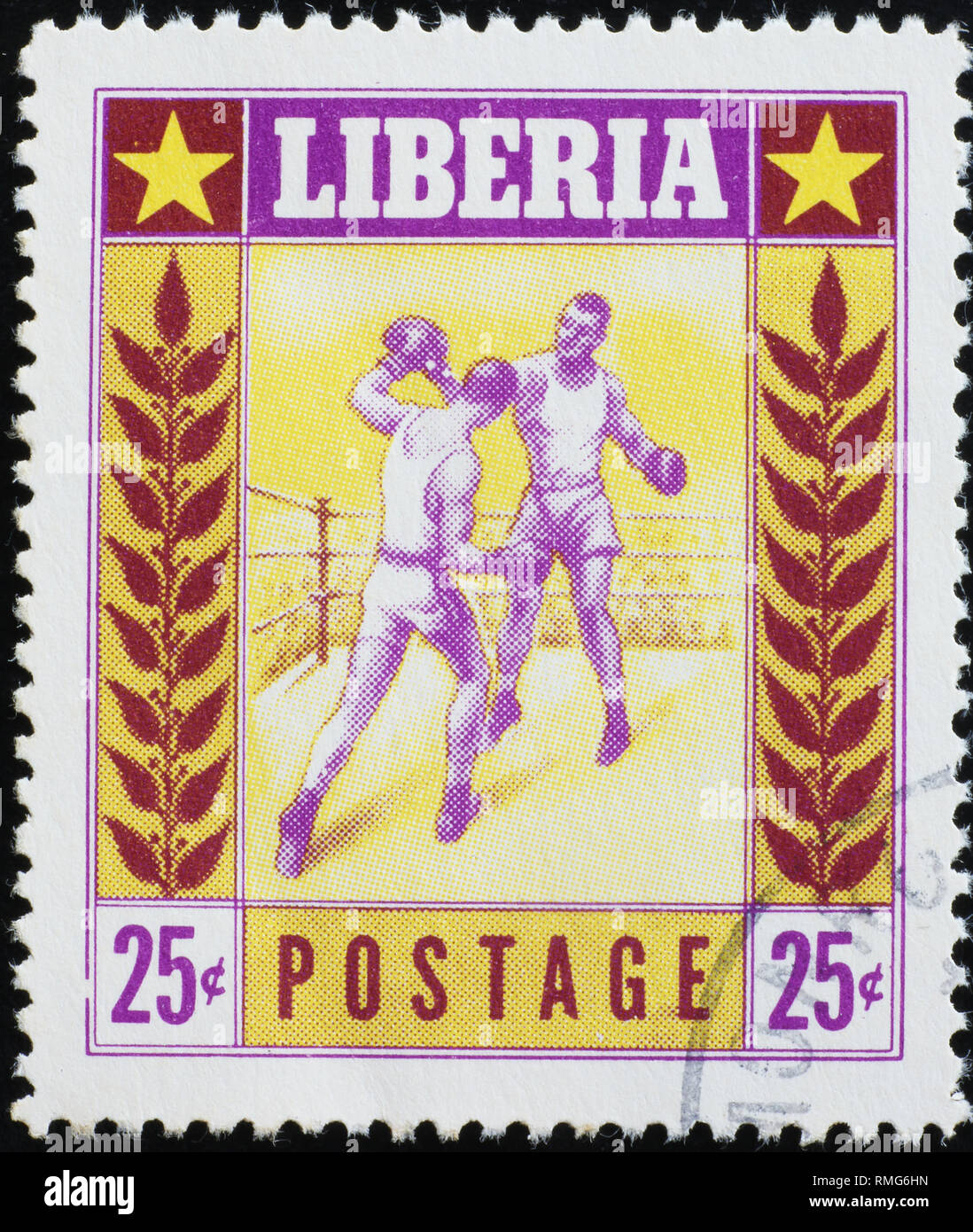 Boxers fighting on old postage stamp of Liberia - Stock Image
