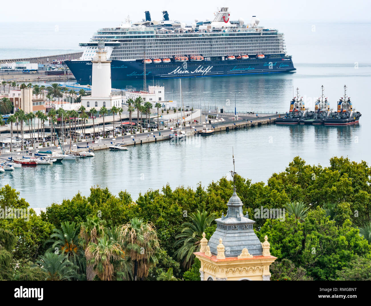 Malaga harbour seen from above. German tourist passenger ship Mein Schiff in port, Malaga, Andalusia, Spain - Stock Image
