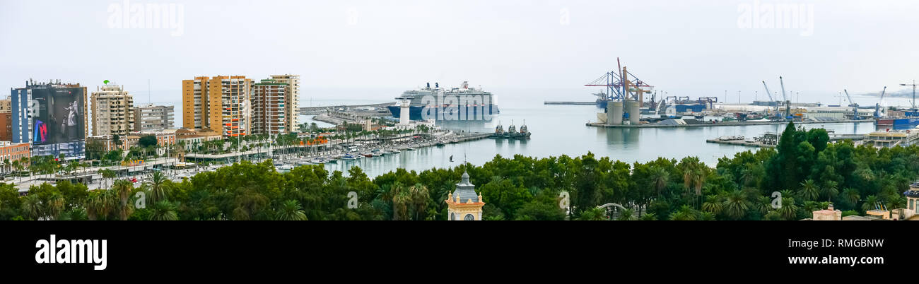 Panorama Malaga harbour with German tourist passenger ship Mein Schiff and port cranes, Malaga, Andalusia, Spain - Stock Image