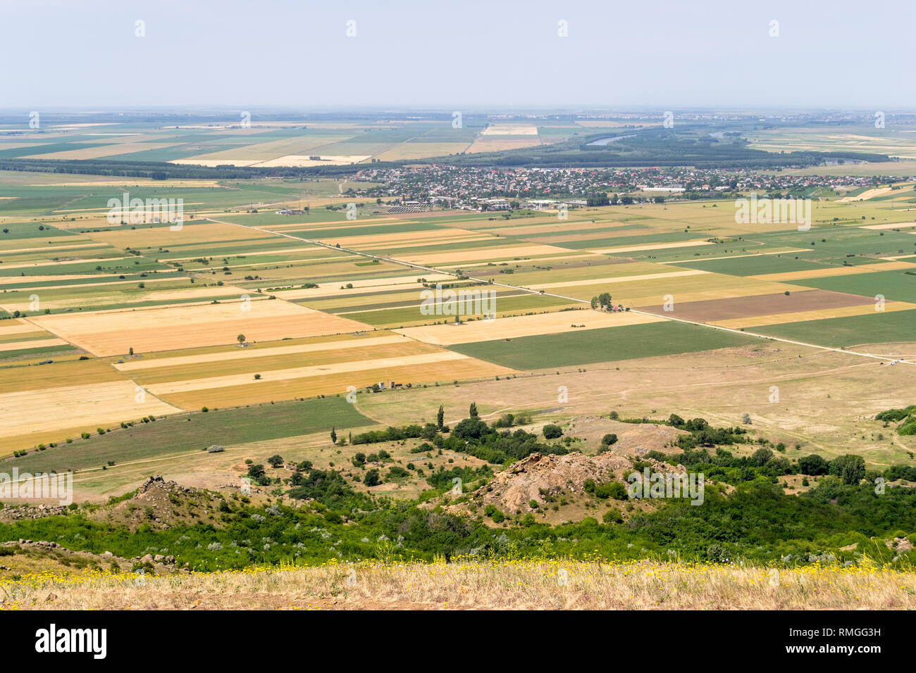 Aerial view of farm lands with crop fields in Dobrogea, Romania, on a hot, late summer day - agriculture in south-east of Europe - Stock Image