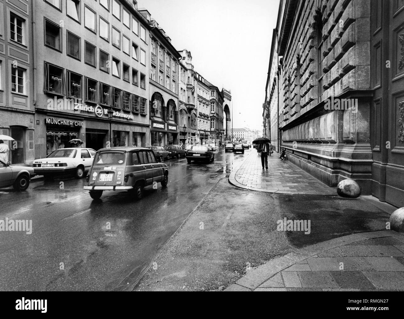 View of the Residenzstrasse in Munich in the direction of the Odeonsplatz. On the right, the facade of the Munich Residenz. (Undated photo). - Stock Image
