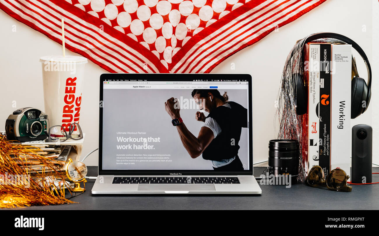 LONDON, UK - SEP 13, 2018: Creative room table with Safari Browser on MacBook Pro laptop showcasing Apple Computers website latest Apple Watch series 4 workout partner presentation - Stock Image