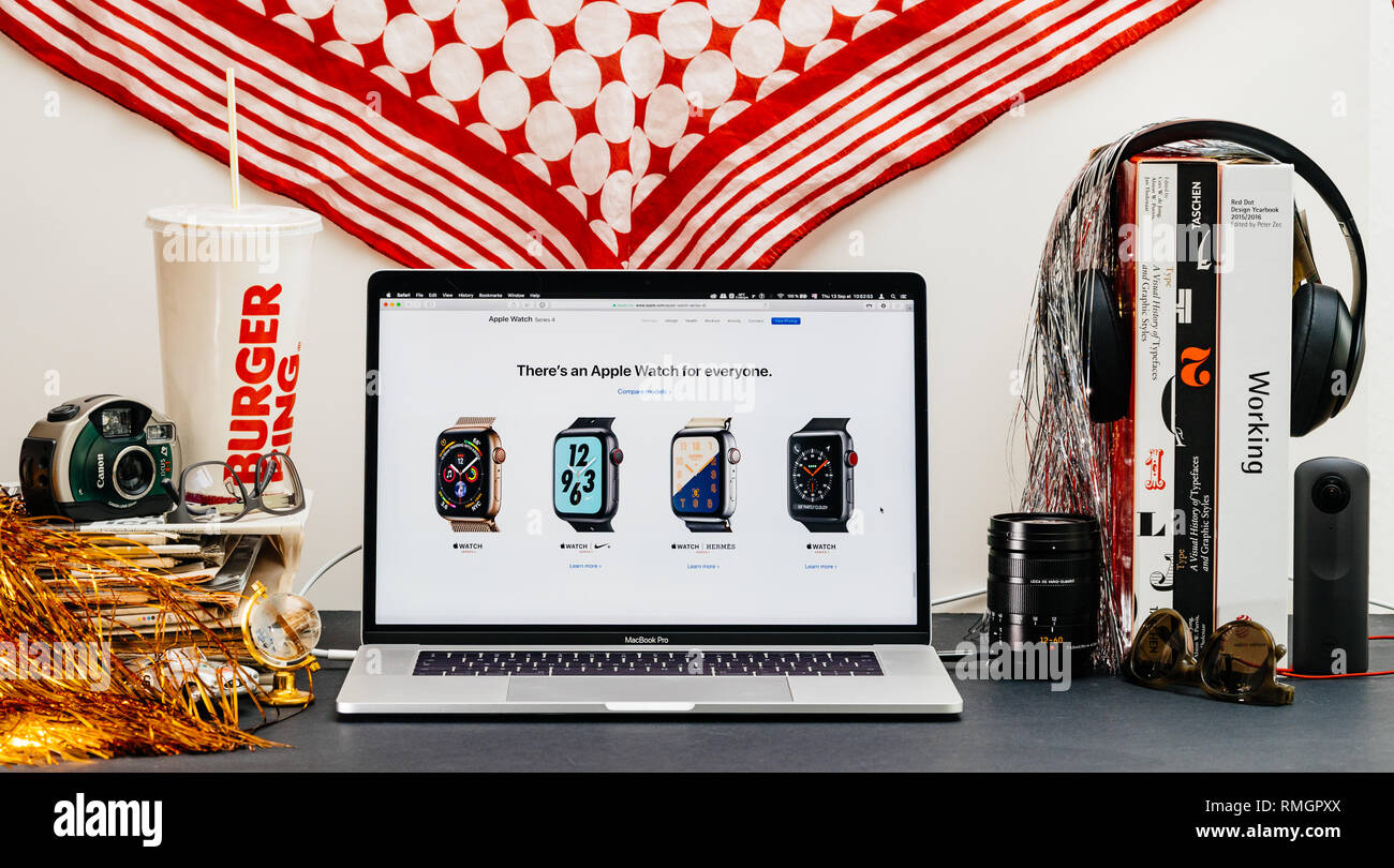 LONDON, UK - SEP 13, 2018: Creative room table with Safari Browser on MacBook Pro laptop showcasing Apple Computers website latest Apple Watch series 4 for everyone - Stock Image