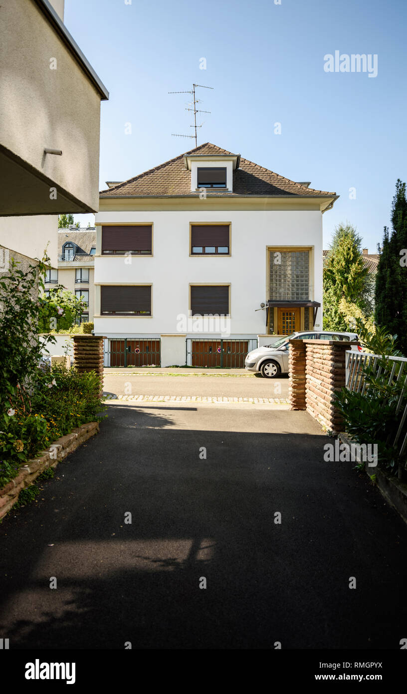 Modern house in french city with nearby parked car tilt shift lens