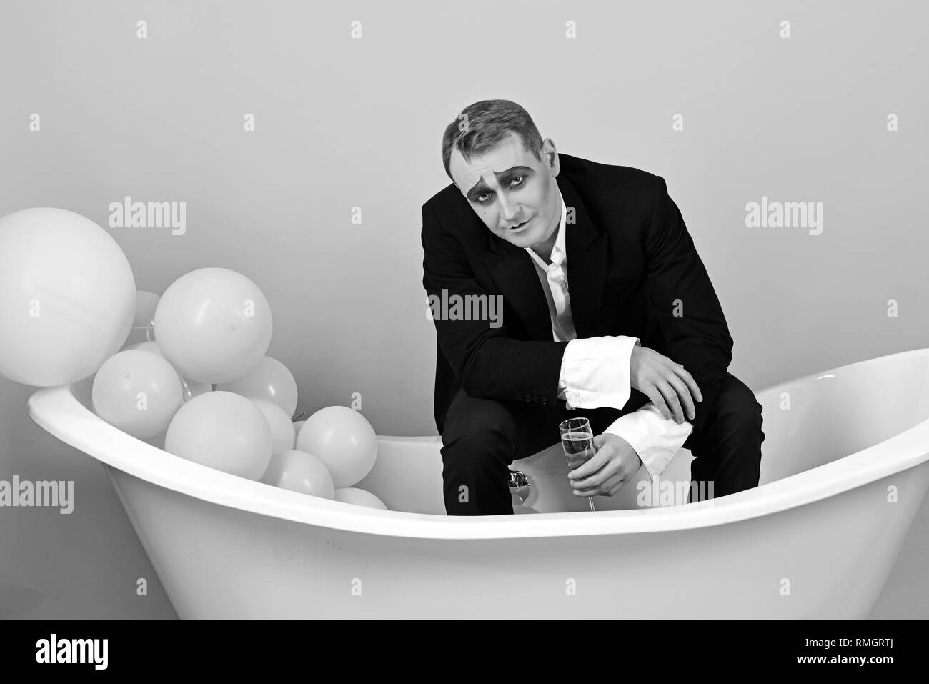 No celebration is complete without bubbly. Comedian actor enjoy theatre party celebrating. Mime man celebrate party in bath. Mime actor has - Stock Image