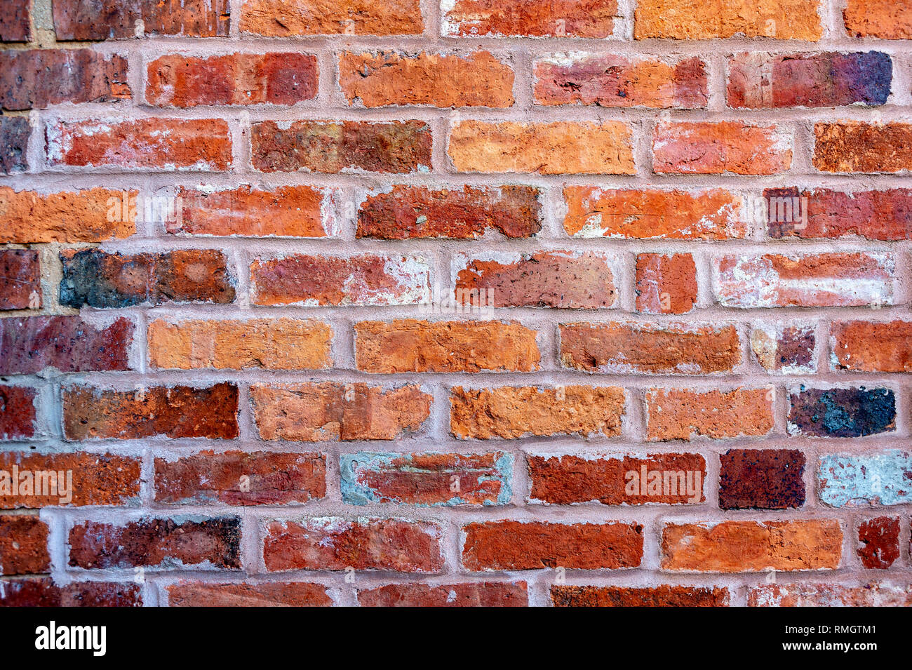 A brick wall built with old bricks - Stock Image