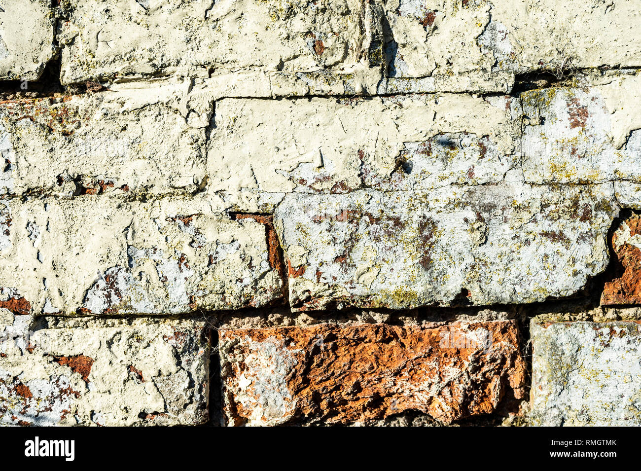 old damaged brick work showing the texture of old bricks - Stock Image