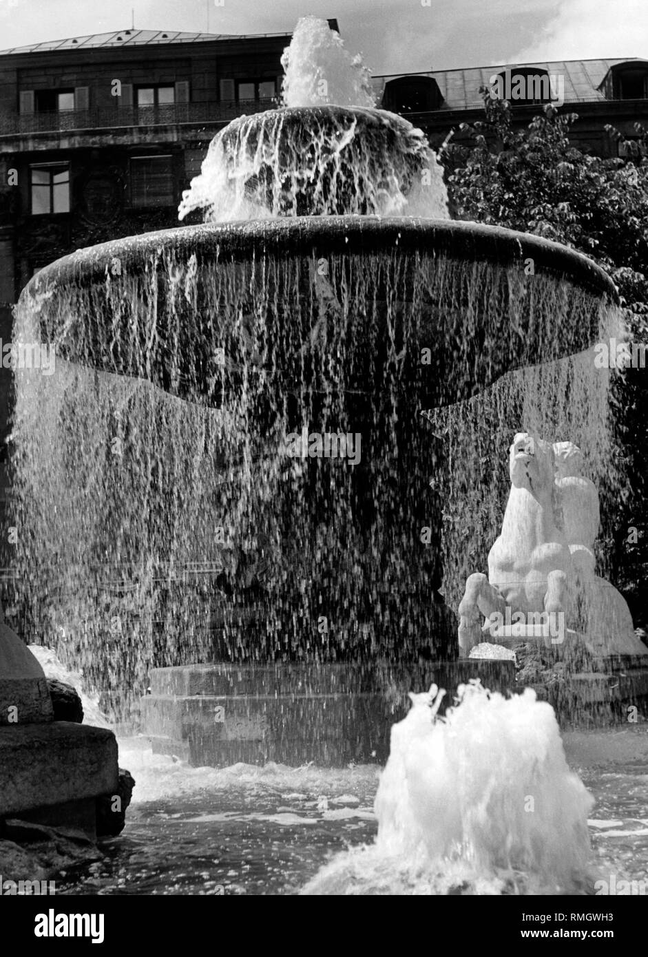 The Wittelsbacher Brunnen (fountain) at the Lenbachplatz in Munich. On the right-hand side a man on a horse (undated picture). - Stock Image