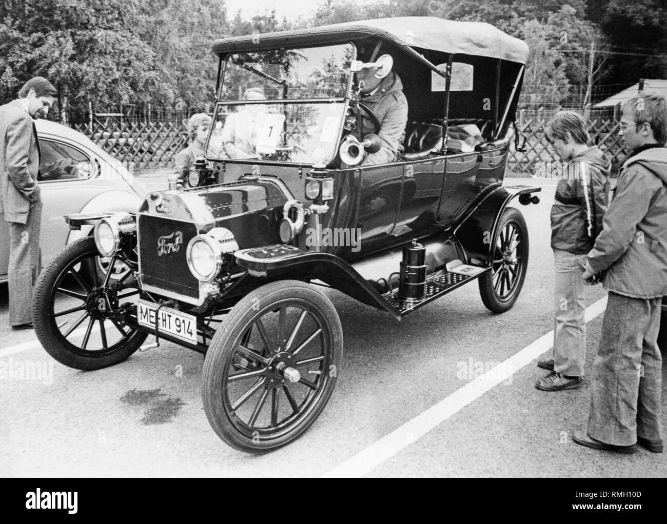 """The Model T, called """"Tin Lizzy"""" was the first automobile in the world to be produced on the assembly line. Next to the Model T there stands a VW Beetle, with which the VW could outbid the sales figures of the Model T. Stock Photo"""