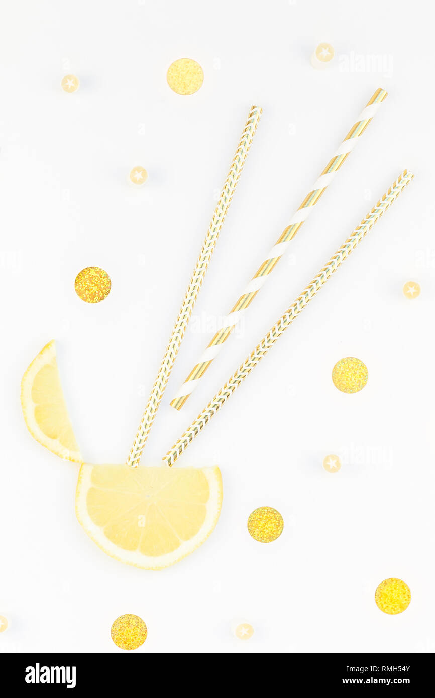 Creative flatlay overhead top view citrus lemon slices and candies white table background with copyspace. Hot summer refreshment lemonade concept. Bev - Stock Image