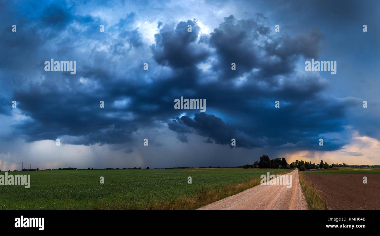 Panoramic image of storm clouds at summer - Stock Image