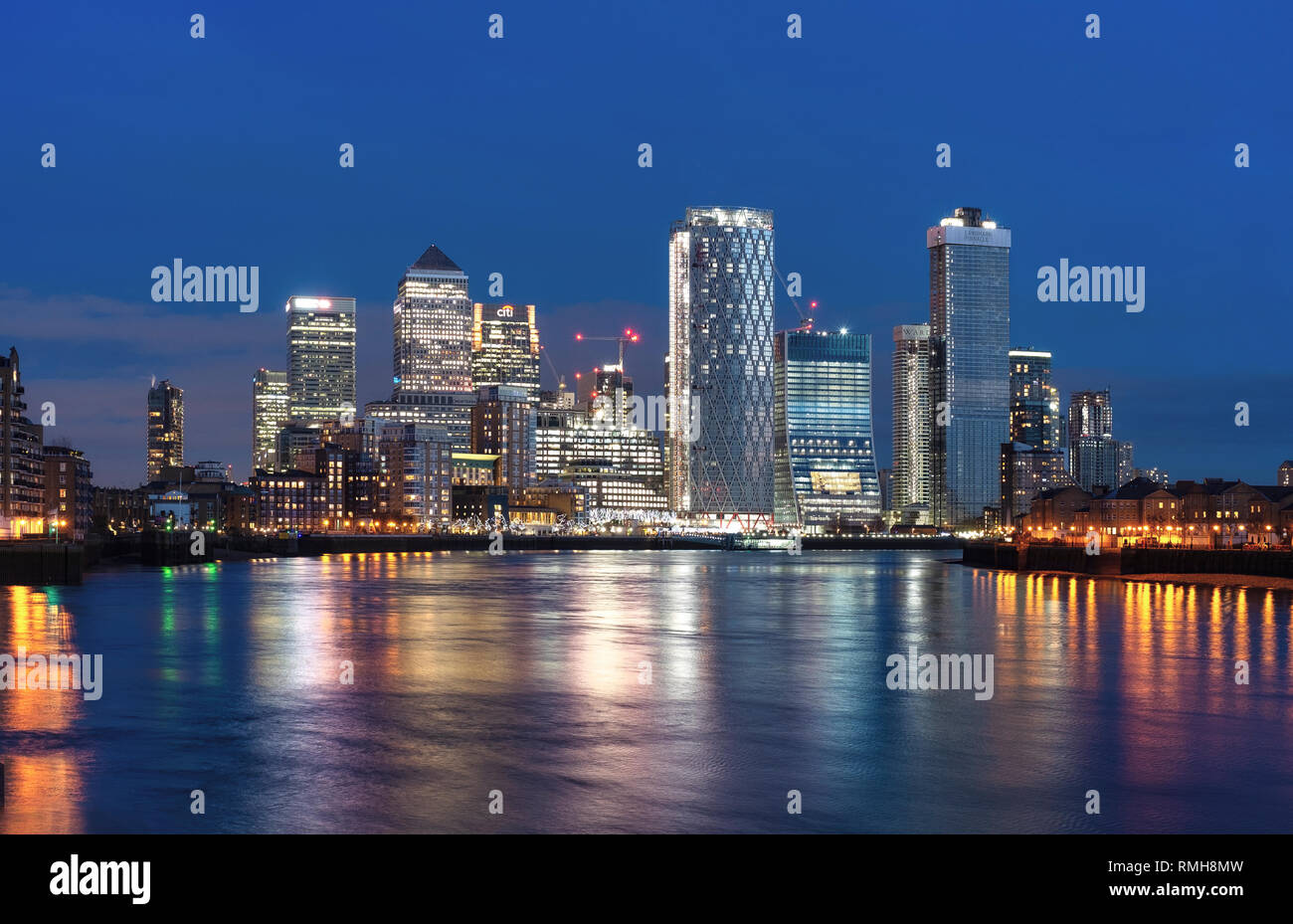Canary Wharf, London, Relecting in the River Thames at Dusk - Stock Image