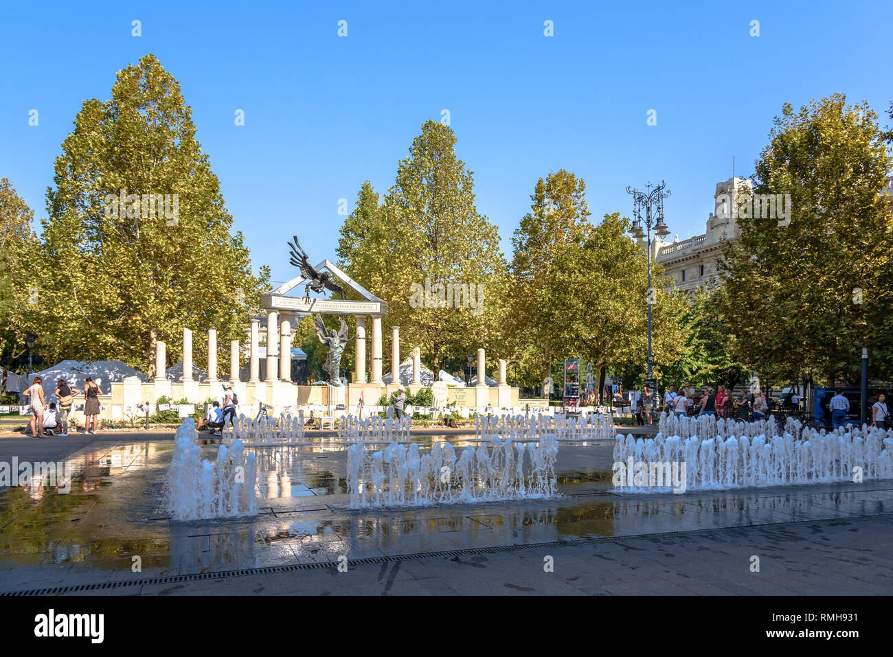The controversial German occupation memorial in Budapest with a fountain - Stock Image