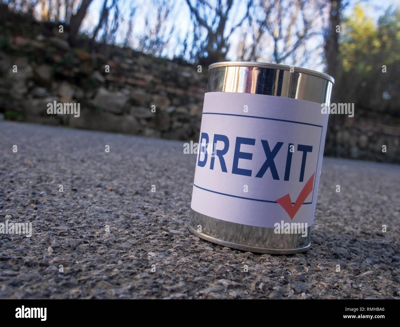 Brexit tin can in the road ready for a kick, UK EU politics metaphor or concept. - Stock Image
