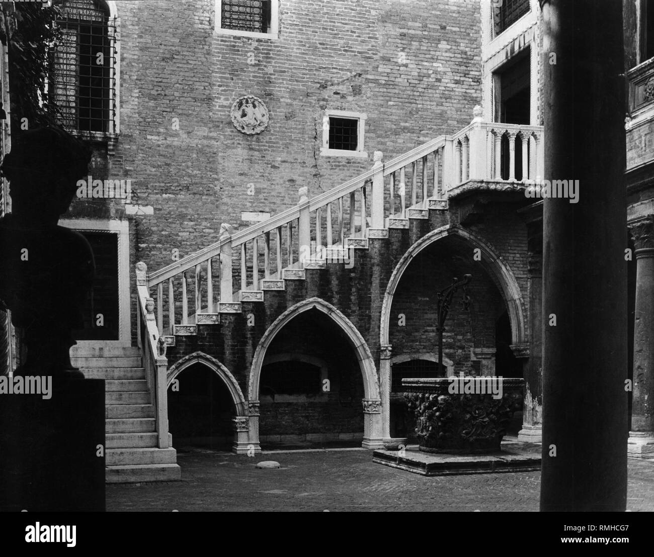 Venetian staircase from the 15th century in a courtyard. - Stock Image