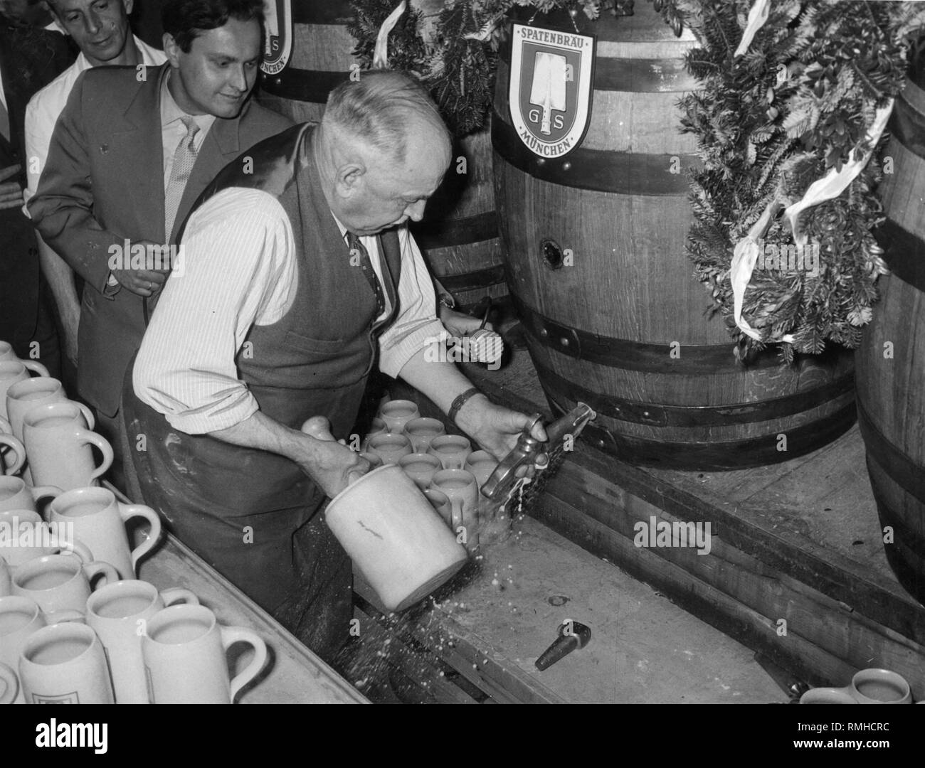 The mayor of Munich, Thomas Wimmer, taps the keg at the Salvator tasting. - Stock Image
