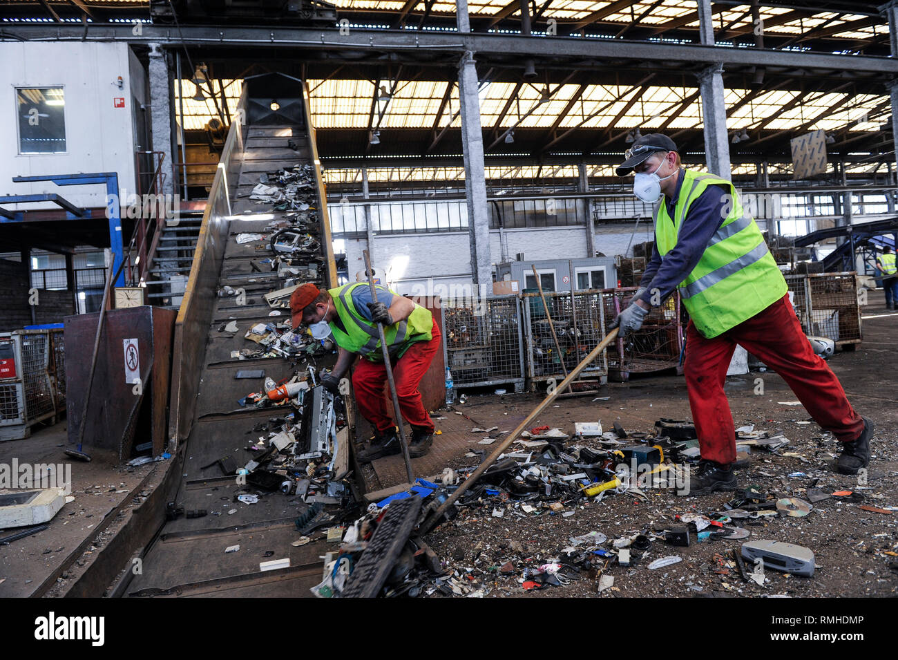 GERMANY, Hamburg, recycling of electronical scrap and old consumer goods at company TCMG, the trash is collected by the urban waste disposal system and than processed and separated here after metals like copper and plastics for further recycling and reuse, by law is not allowed to export e-scrap to africa and other countries - Stock Image