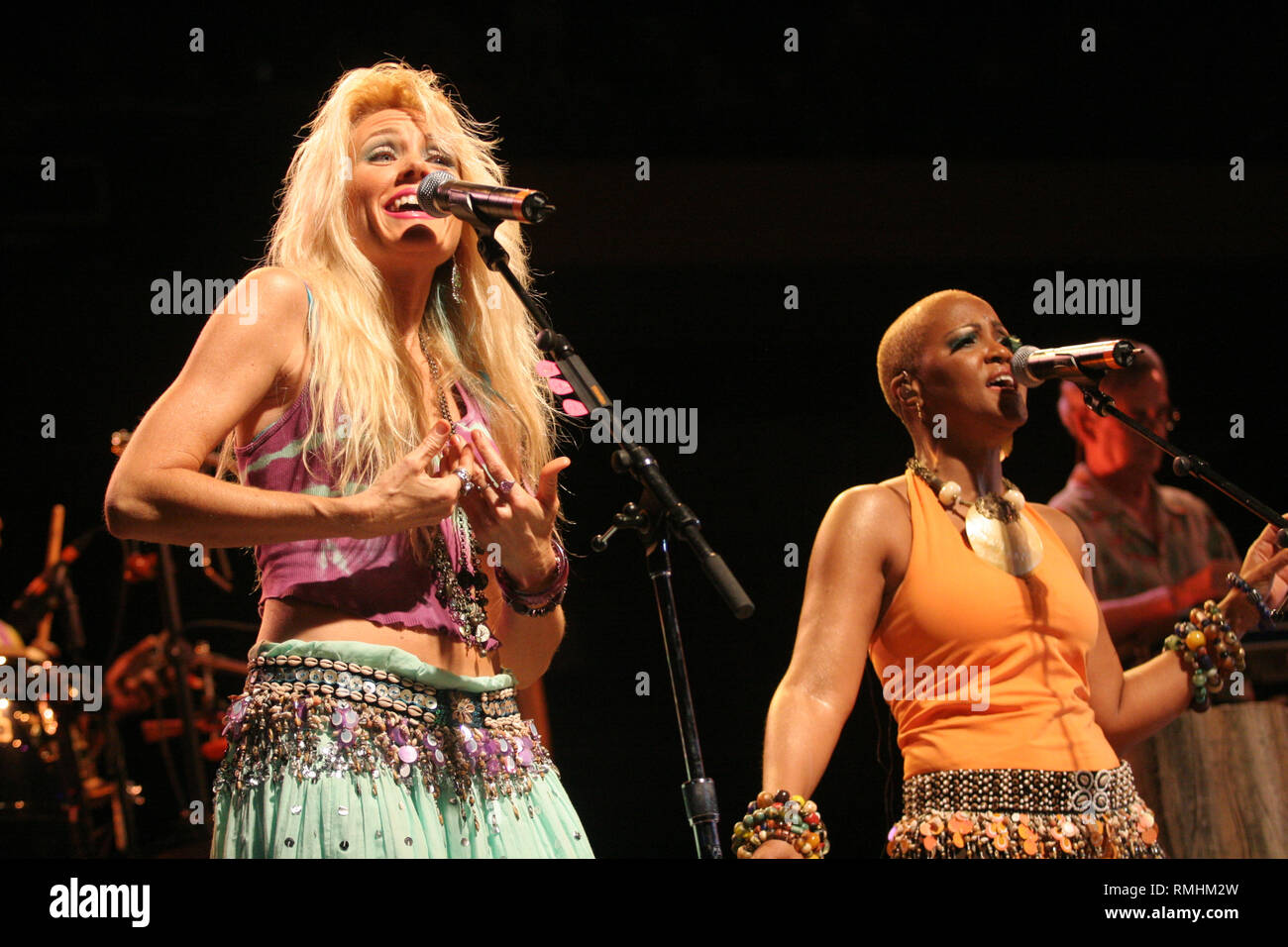 Singers are shown onstage during a Jimmy Buffett concert