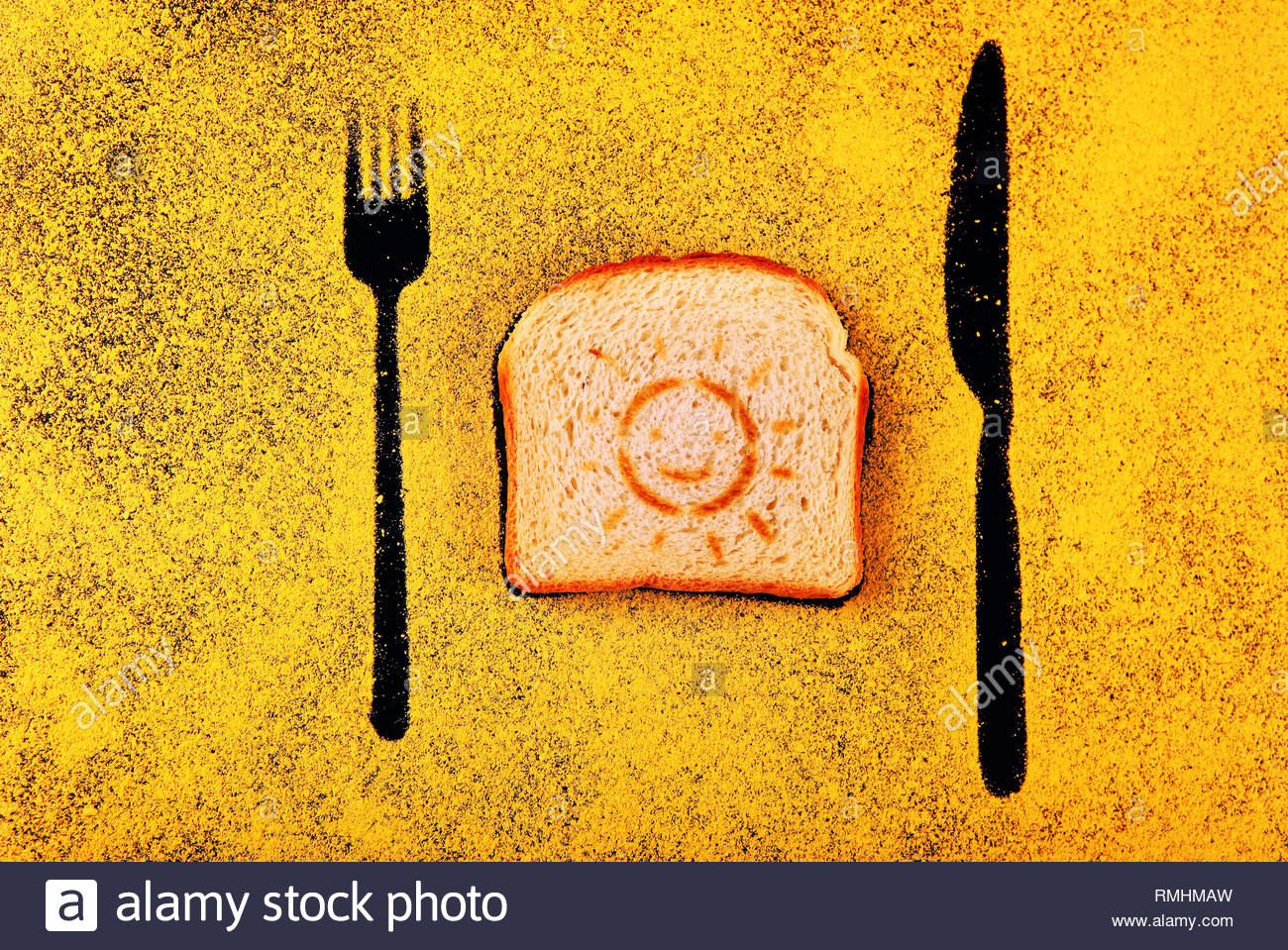 toast sun symbol fork knife shadow chalkboard yellow chalk - Stock Image