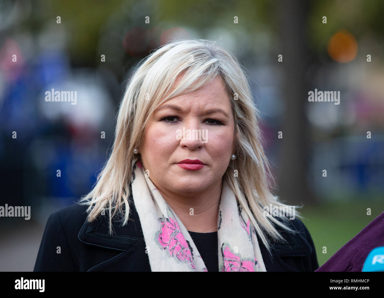 President of Sinn Fein, Mary Lou McDonald and her deputy, Michelle O'Neill, give an interview to the press on College Green. - Stock Image