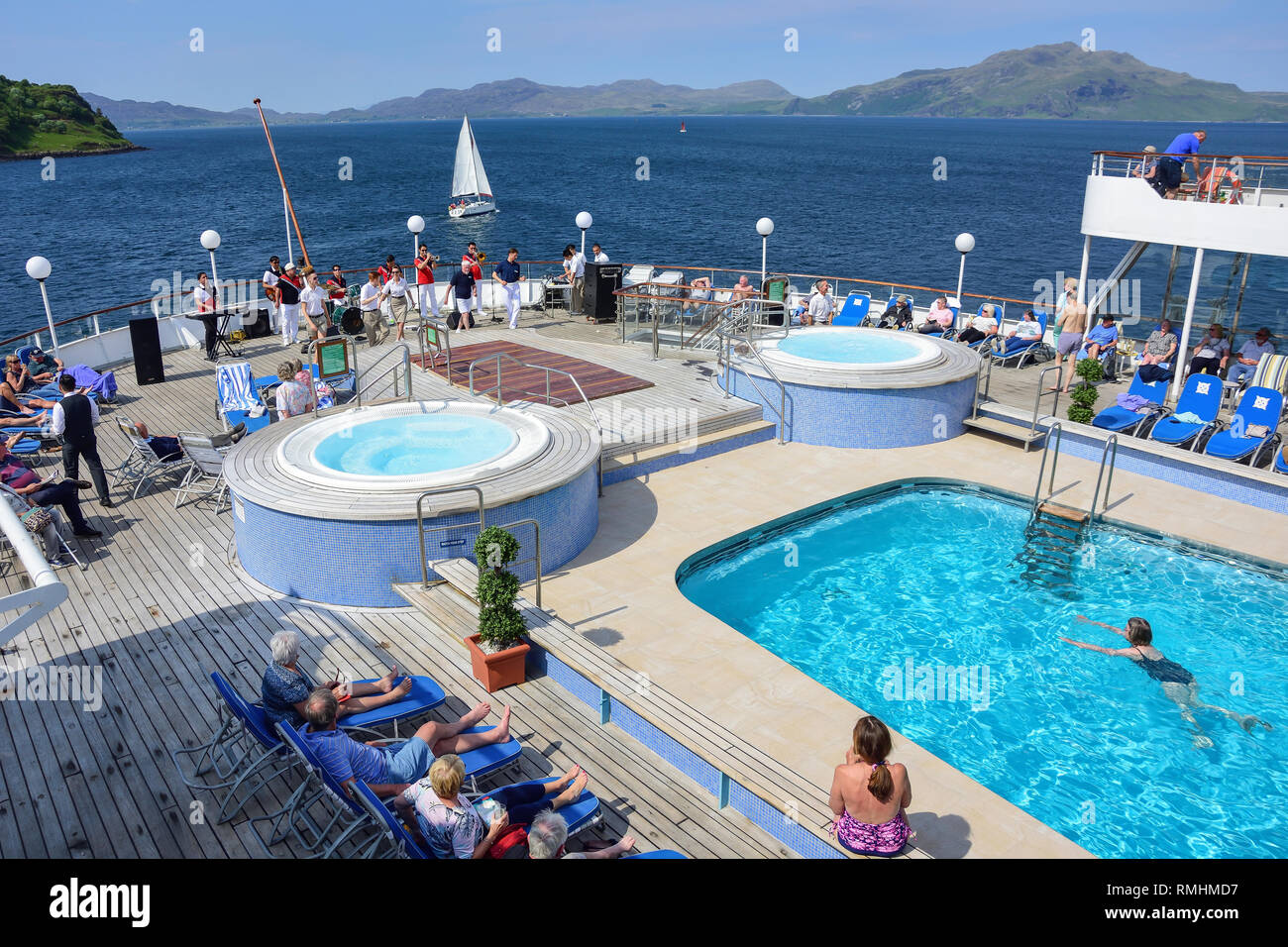 'Sail away' entertainment onboard Fred Olsen Boudicca cruise ship on leaving Tobermory, Isle of Bute, Inner Hebrides, Scotland, United Kingdom - Stock Image