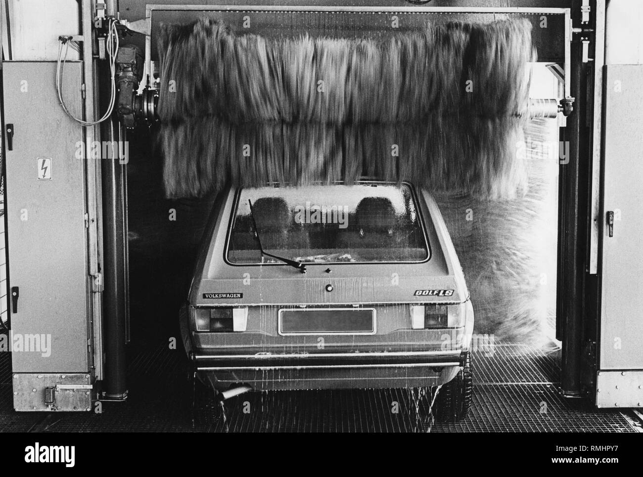 A VW Golf LS in a car wash. - Stock Image