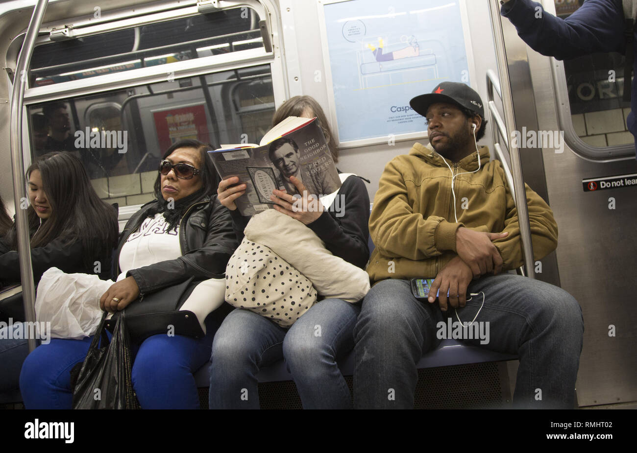 Woman Reads The Book The Good Neighbor A Biography Of Fred Rogers Mr Rogers The American Children S Show Host Ny City Subway Train Stock Photo Alamy