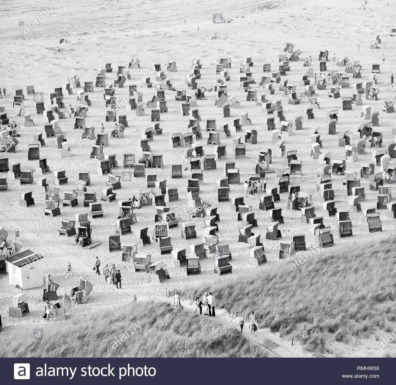 Beach baskets on the sand beach in the seaside resort Warnemuende in Rostock in the state Mecklenburg-West Pomerania on the territory of the former GDR, German Democratic Republic. - Stock Image