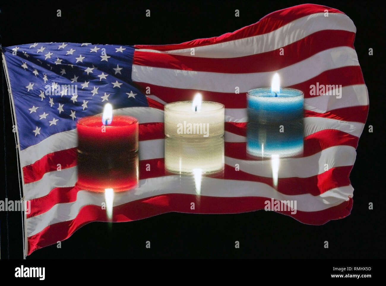 Red White And Blue Candles In Front Of An American Flag On A Black