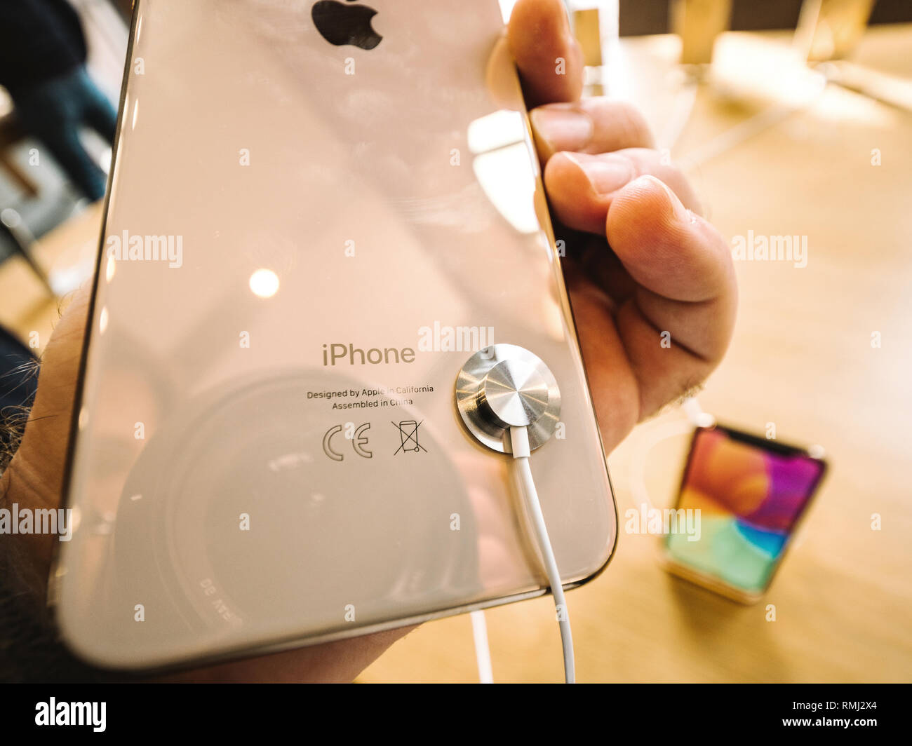 STRASBOURG, FRANCE - SEP 21, 2018: Rear view of the gold iPhone Xs Max telephone smartphone in Apple Store  - Stock Image
