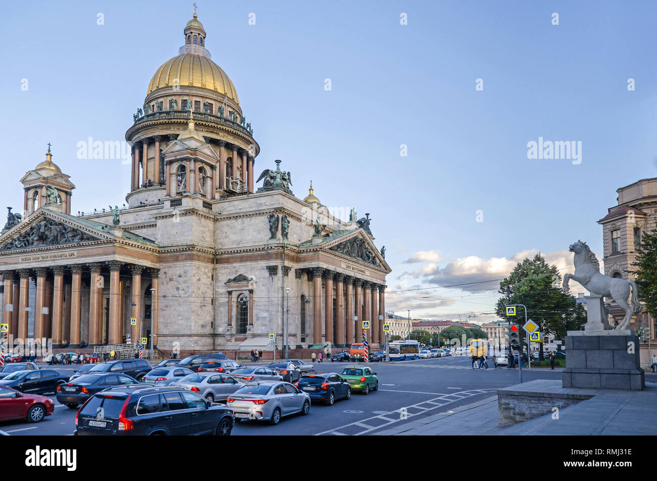 Saint Petersburg, Russia -  September 25, 2018: St Isaac's Square with the Saint Isaac's Cathedral or Isaakievskiy Sobor and a rush hour traffic - Stock Photo
