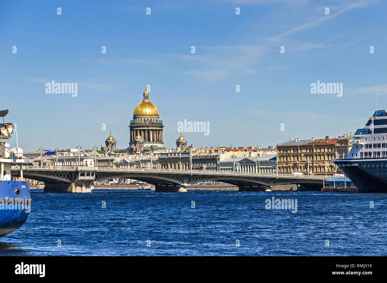 Saint Petersburg, Russia -  June 27, 2018: Saint Isaac's Cathedral behind the Blagoveshchenskiy bridge and the river Bolshaya Neva with the maritime t - Stock Image