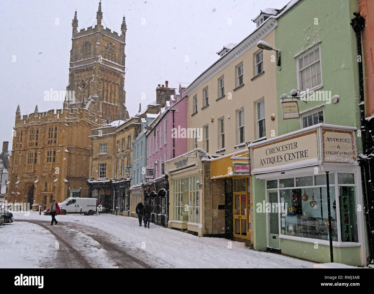 Winter snow in the market place, Cirencester town centre, Gloucestershire Cotswolds, South West England, UK - Stock Image
