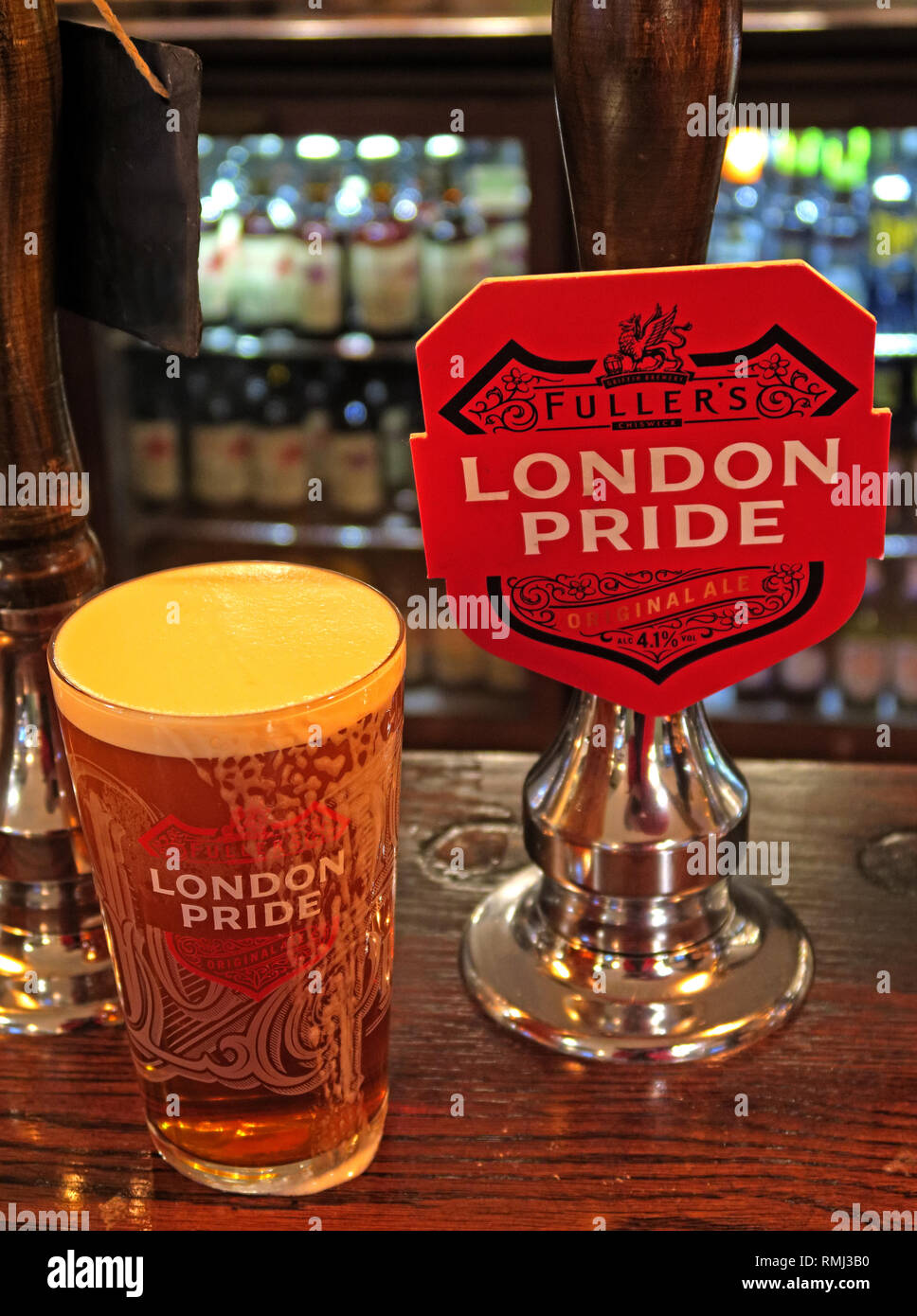 Fullers London Pride hand pump on a bar / pub, North West England, Best bitter, CAMRA ale alcoholic beverage, brewed in Chiswick, West London - Stock Image