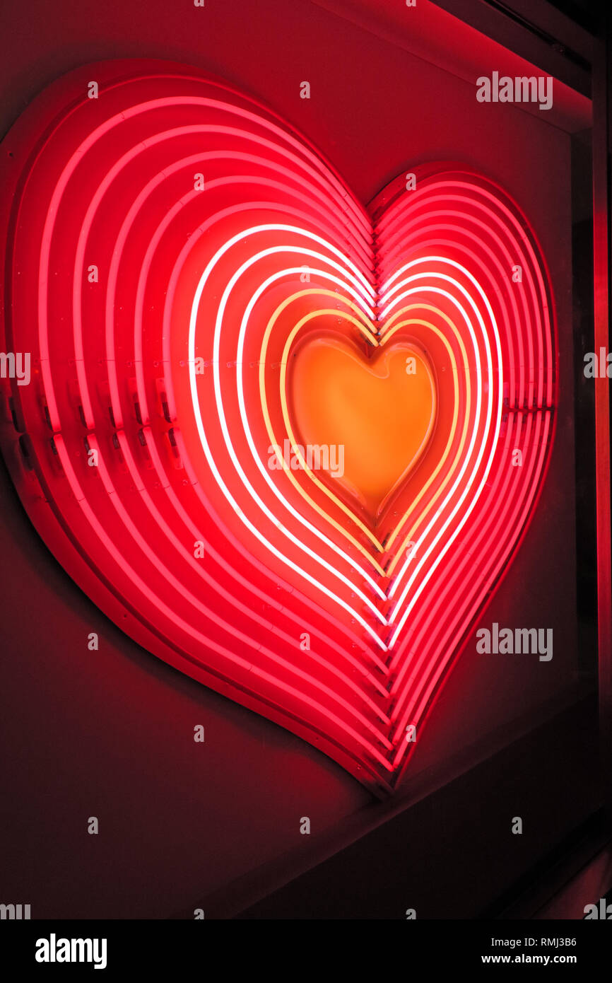 Pink Neon Heart, Love, red, white, orange, for St Valentines Day, 14th February, London, Oxford Street - Stock Image