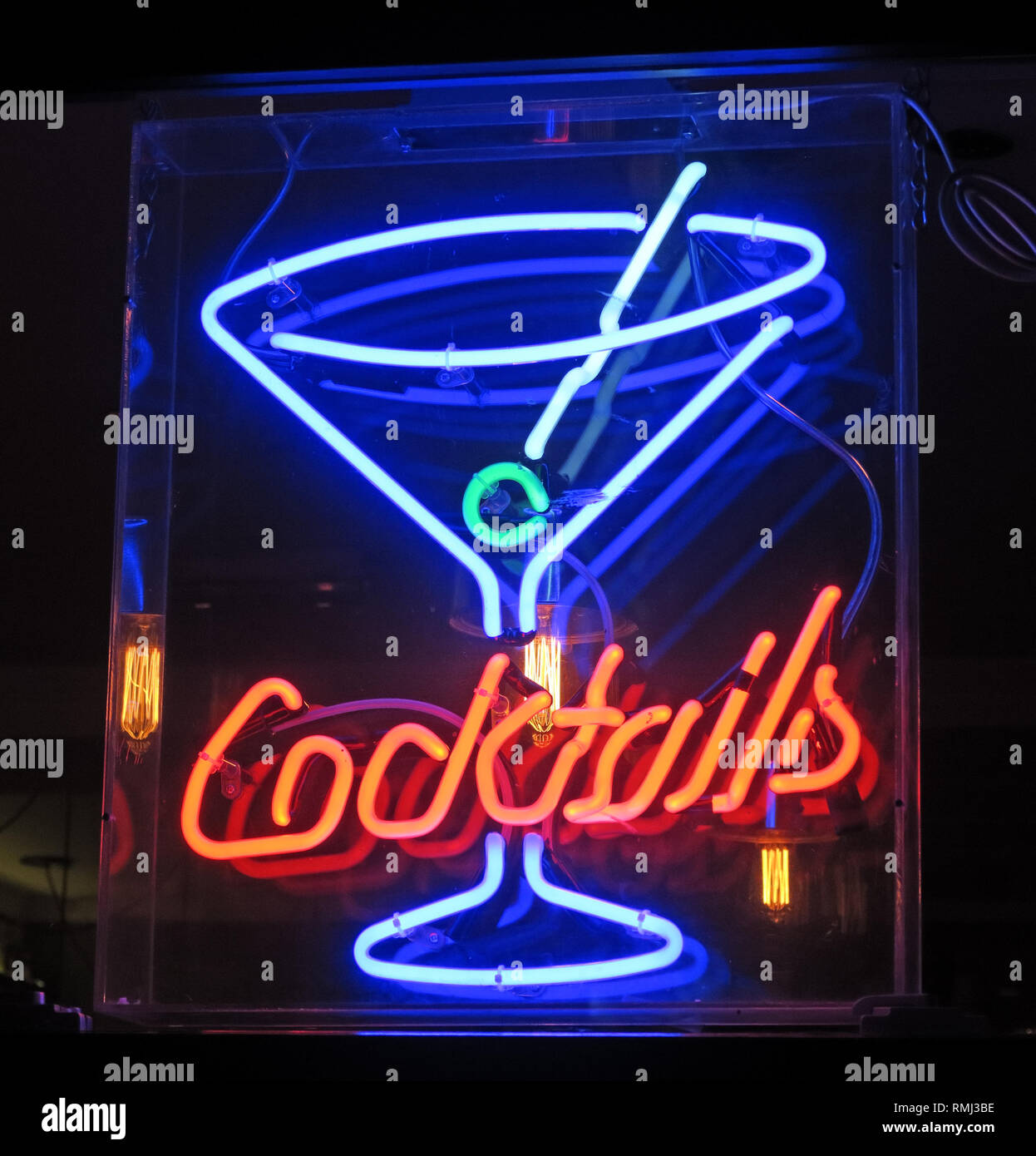 Neon Cocktails sign, lit in the evening, in a Soho bar,London, South East England, UK - Stock Image
