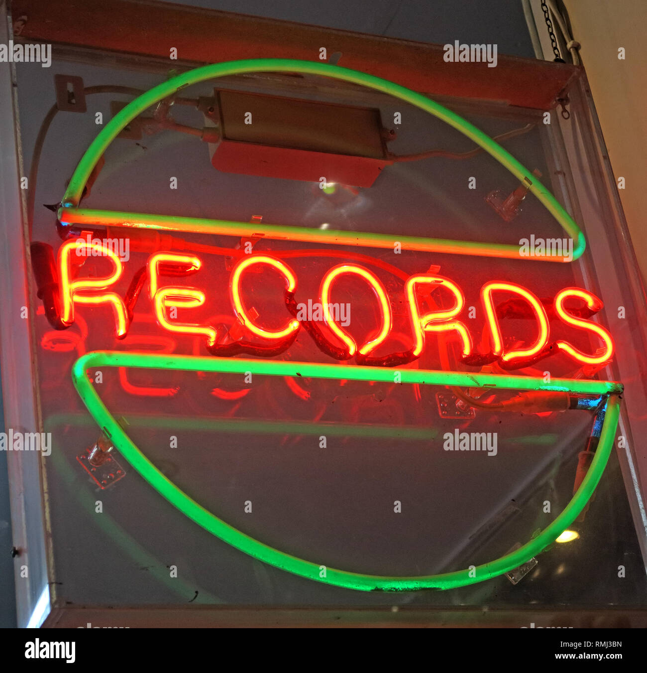 Neon sign, at a record shop, vinyl disks, SoHo, London, South East England, UK - Stock Image