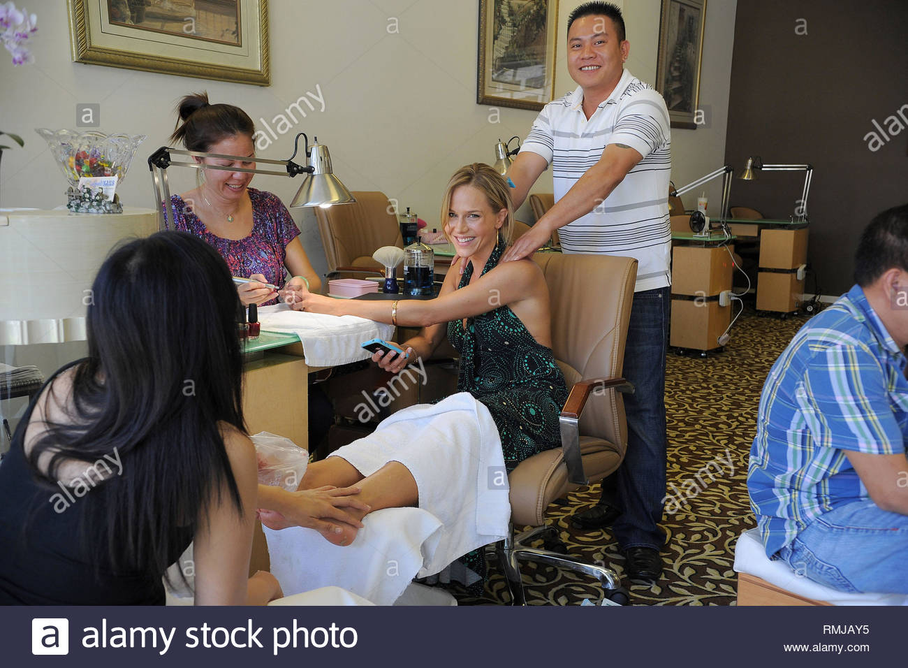 *EXCLUSIVE* Los Angeles, CA - Actress Julie Benz shows her big smile and a  first look at her engagement ring while getting a mani-pedi and massage  from ...