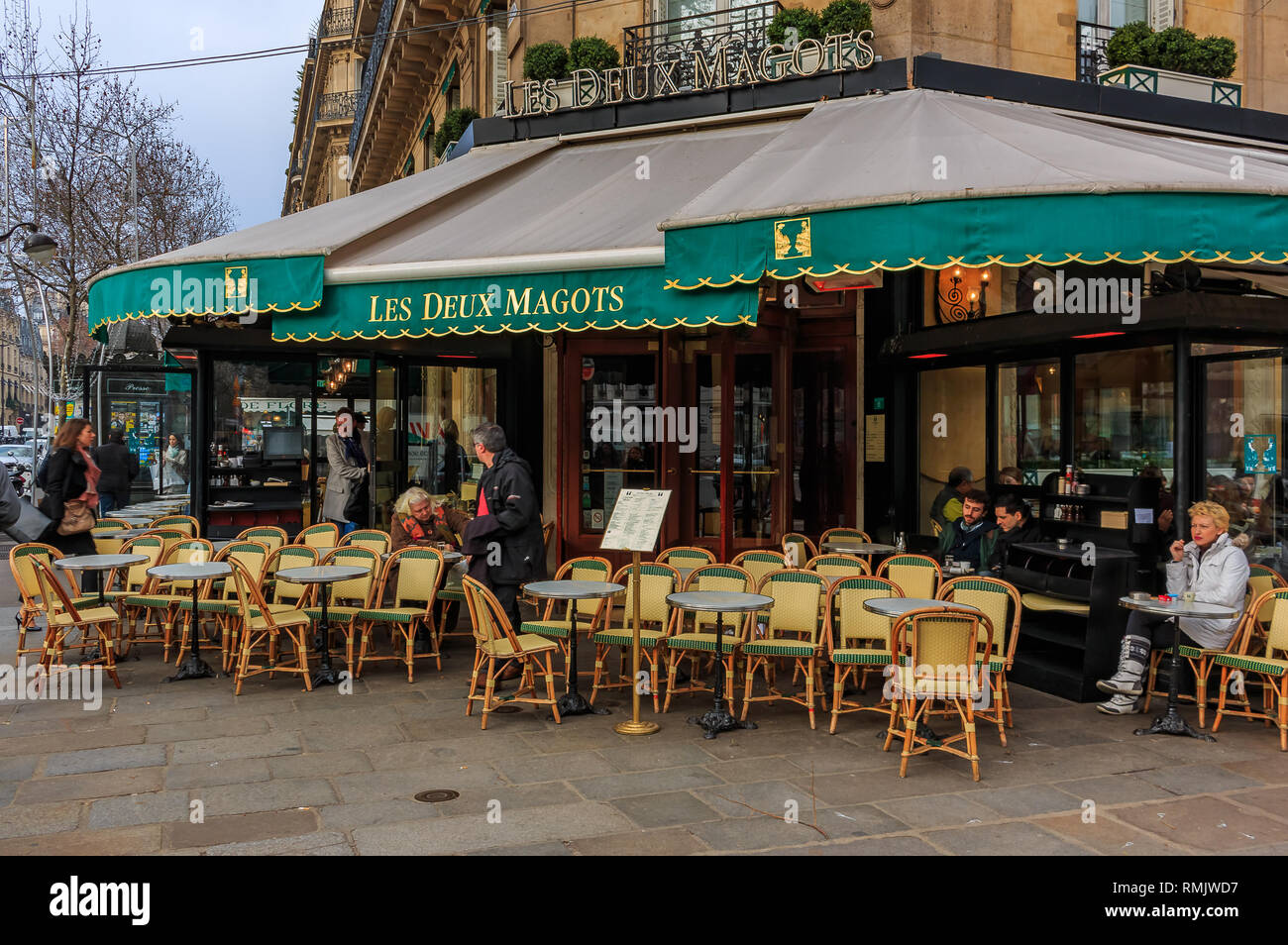 Paris, France - January 22, 2015: Outdoor seating at Les Deux Magots iconic brasserie serving traditional French fare and famous for having hosted gue - Stock Image