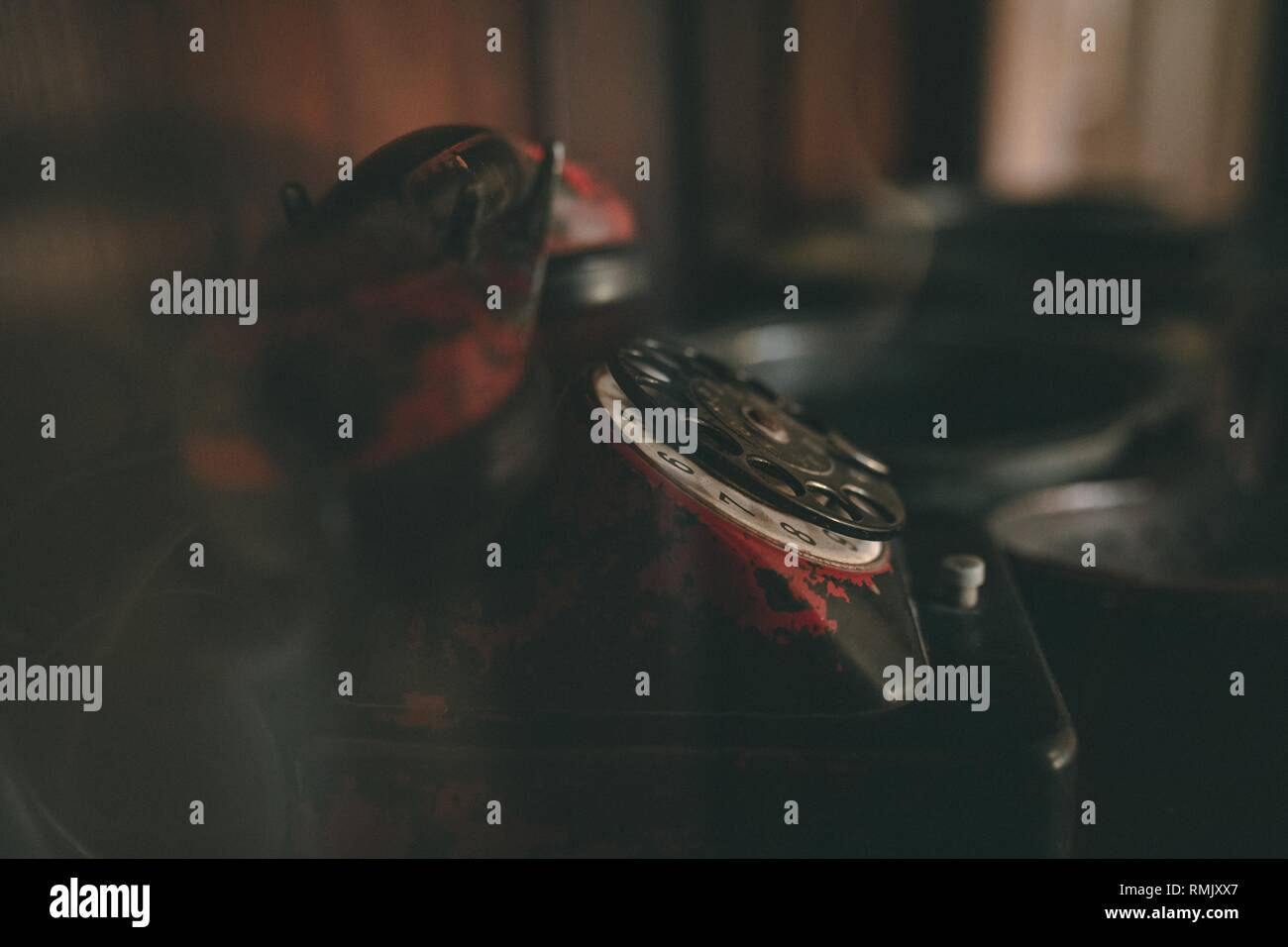 Photo of a vintage black and red worn out phone - Stock Image