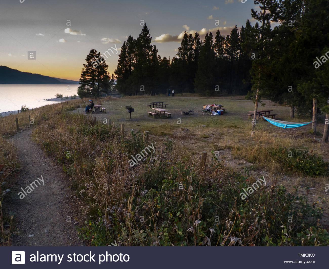 Picnic tables at swimming beach, Colter Bay, Grand Teton National Park, Teton County, Wyoming, USA - Stock Image