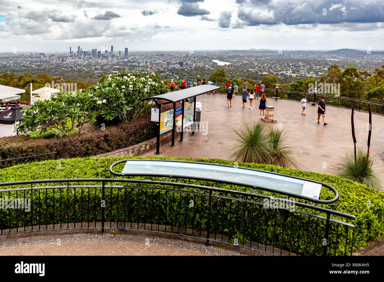 BRISBANE, Australia - January 9 2019: People viewing Brisbane CBD skyscrapers from Mount Coot-tha lookout - Stock Image