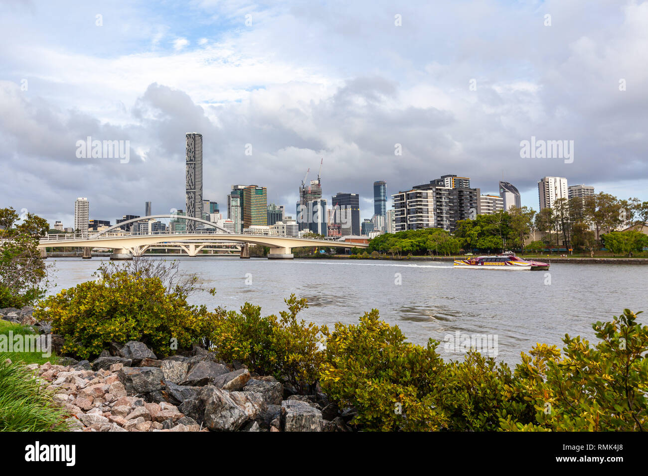 BRISBANE, Australia - January 9 2019: CityCat ferry sailing the Brisbane river among the high-rise buildings - Stock Image