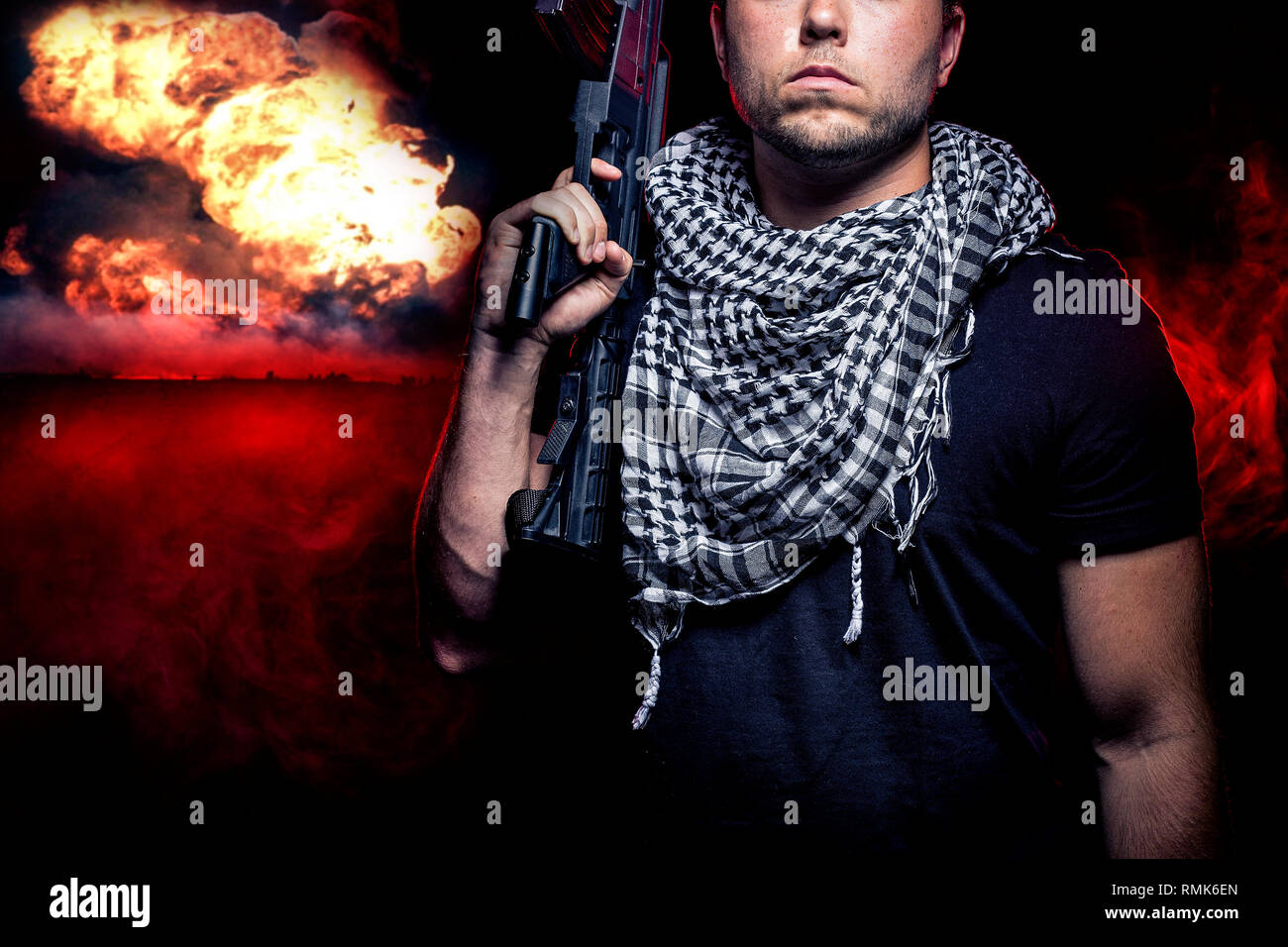 Soldier with a gun surviving bombs that are weapons of mass destruction or a nuclear war. The image depicts warfare and apocalyptic WW3. - Stock Image