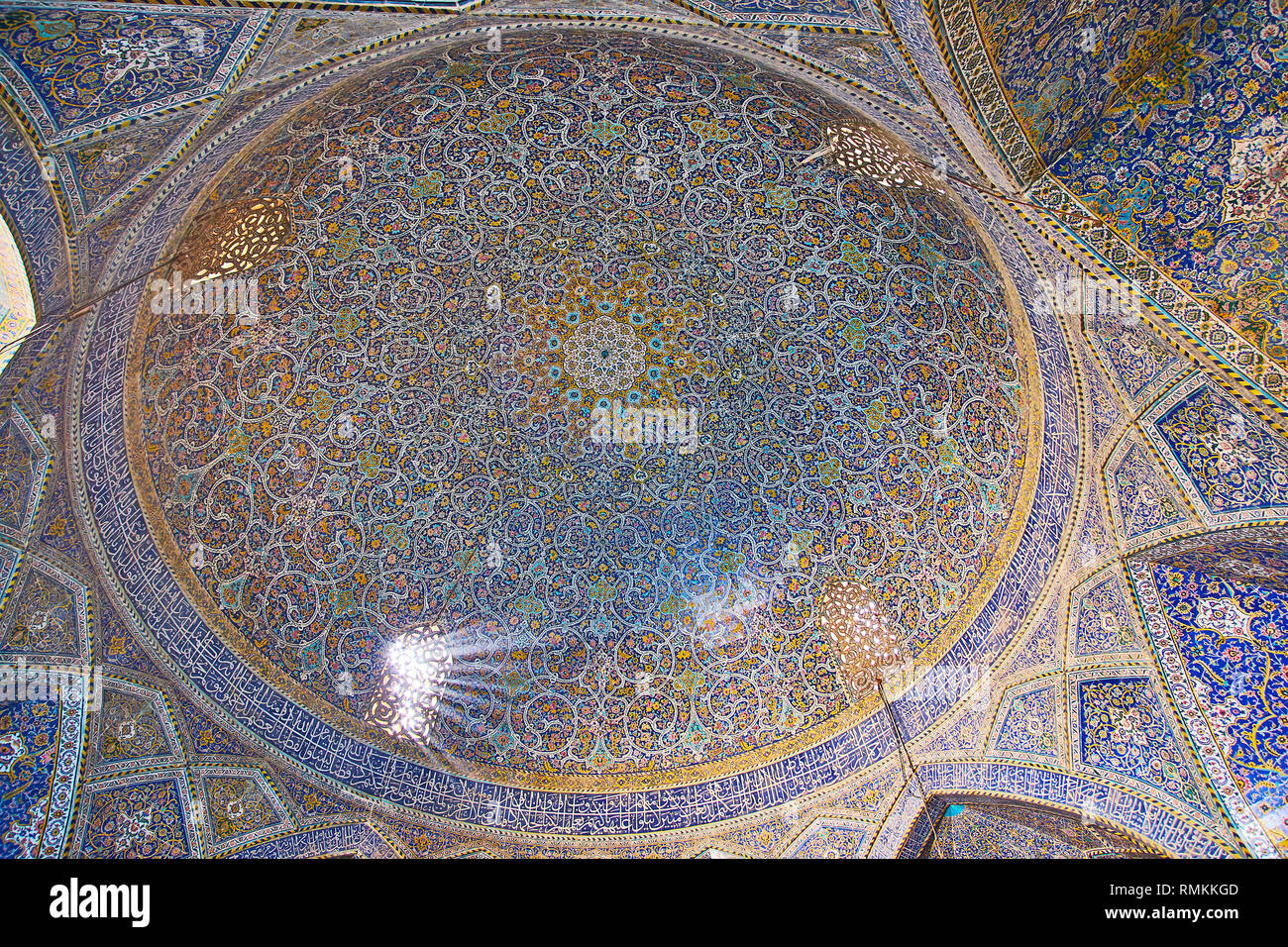 ISFAHAN, IRAN - OCTOBER 21, 2017: Richly decorated dome of Seyed Mosque with stunning tile pattern, Quranic calligraphy, muqarnas and Persian screens, - Stock Image