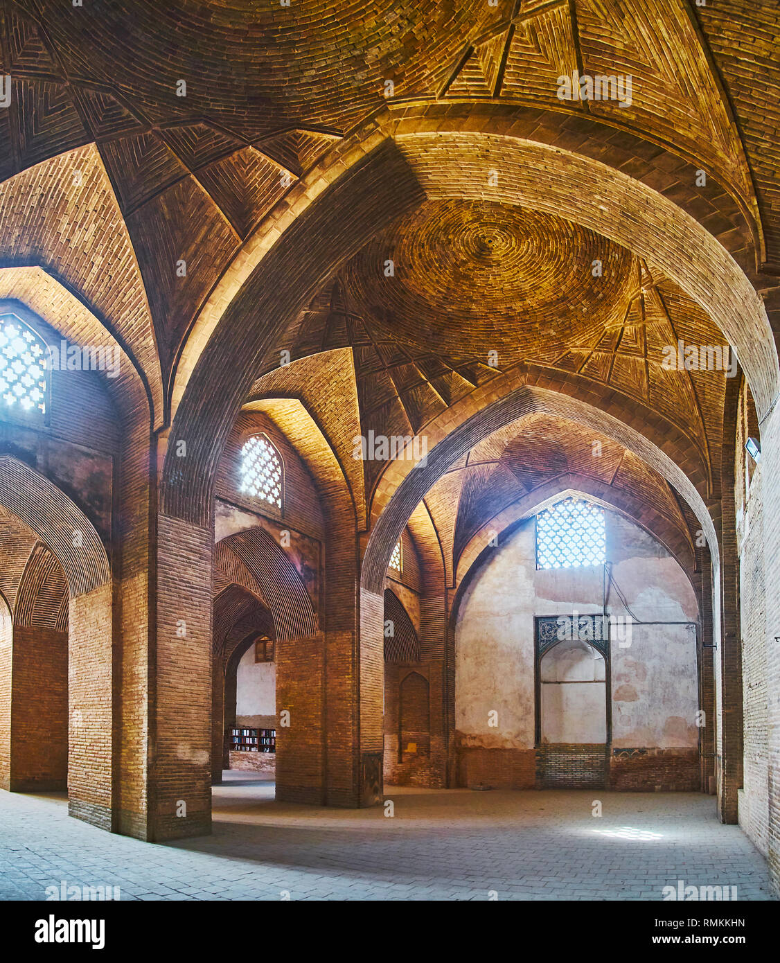 ISFAHAN, IRAN - OCTOBER 21, 2017: The medieval brick Northern shabestan of Jameh Mosque with scenic vault, massive columns and Persian screens, provid - Stock Image