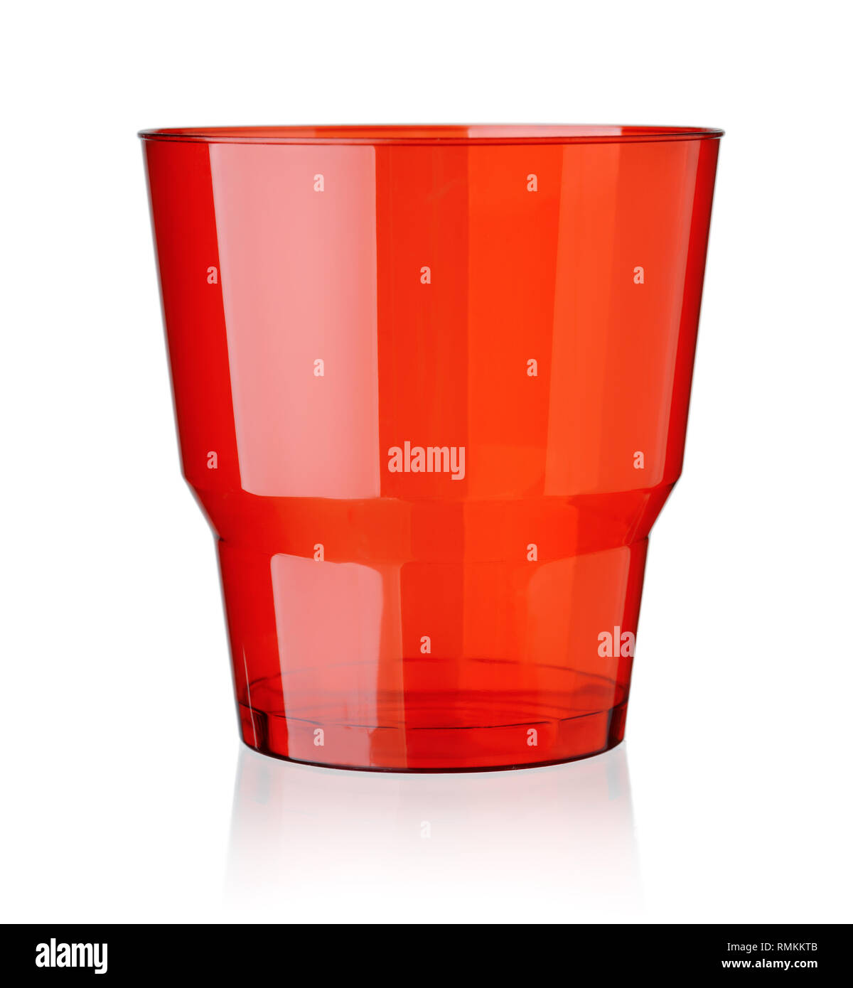 Red empty transparent plastic cup isolated on white - Stock Image