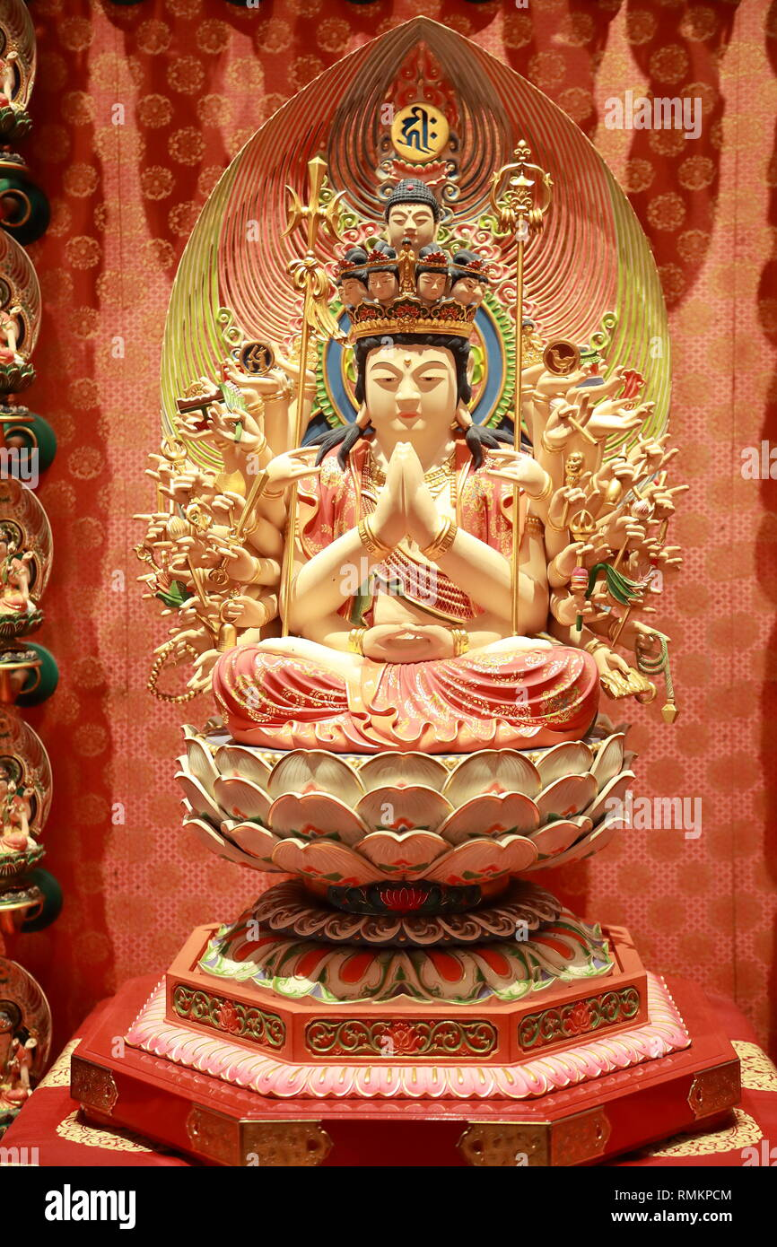 Wooden statues in Singapore's Buddhist Tooth Relic Temple, Singapore - Stock Image