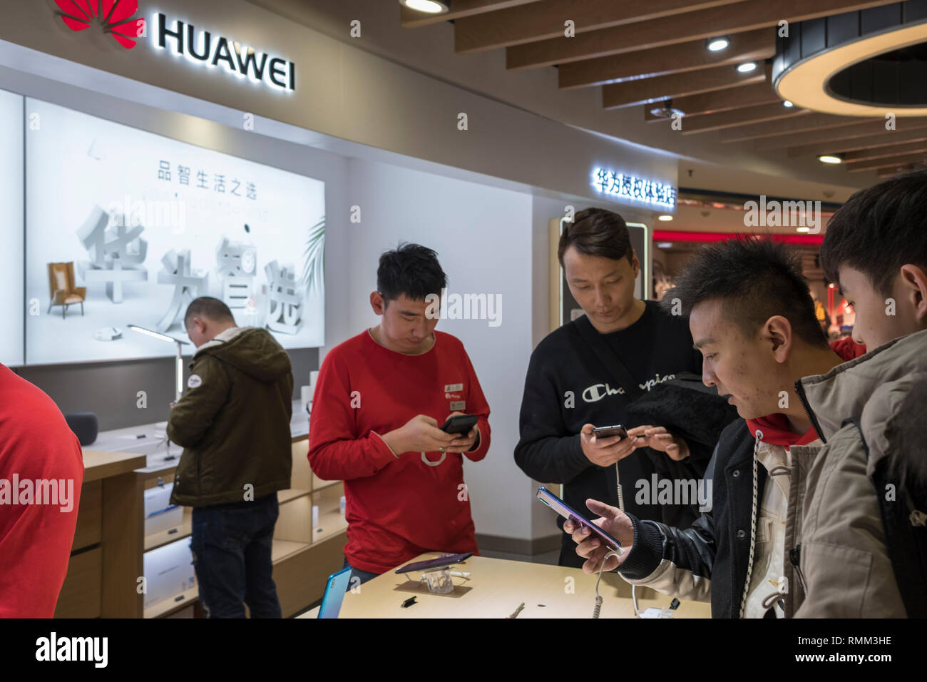 Visitors try out the products in a Huawei store in Beijing, China. 14-Feb-2019 - Stock Image